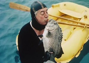 Harold Holt in diving gear with fish taken from a home moy.
